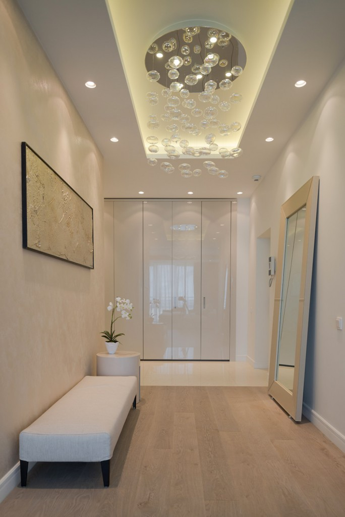 fascinating-entryway-decor-ideas-with-white-leather-couch-and-modern-hallway-lighting-also-wood-laminated-flooring-ideas