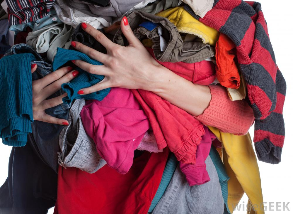 http://images.wisegeek.com/woman-holding-pile-of-clothes.jpg